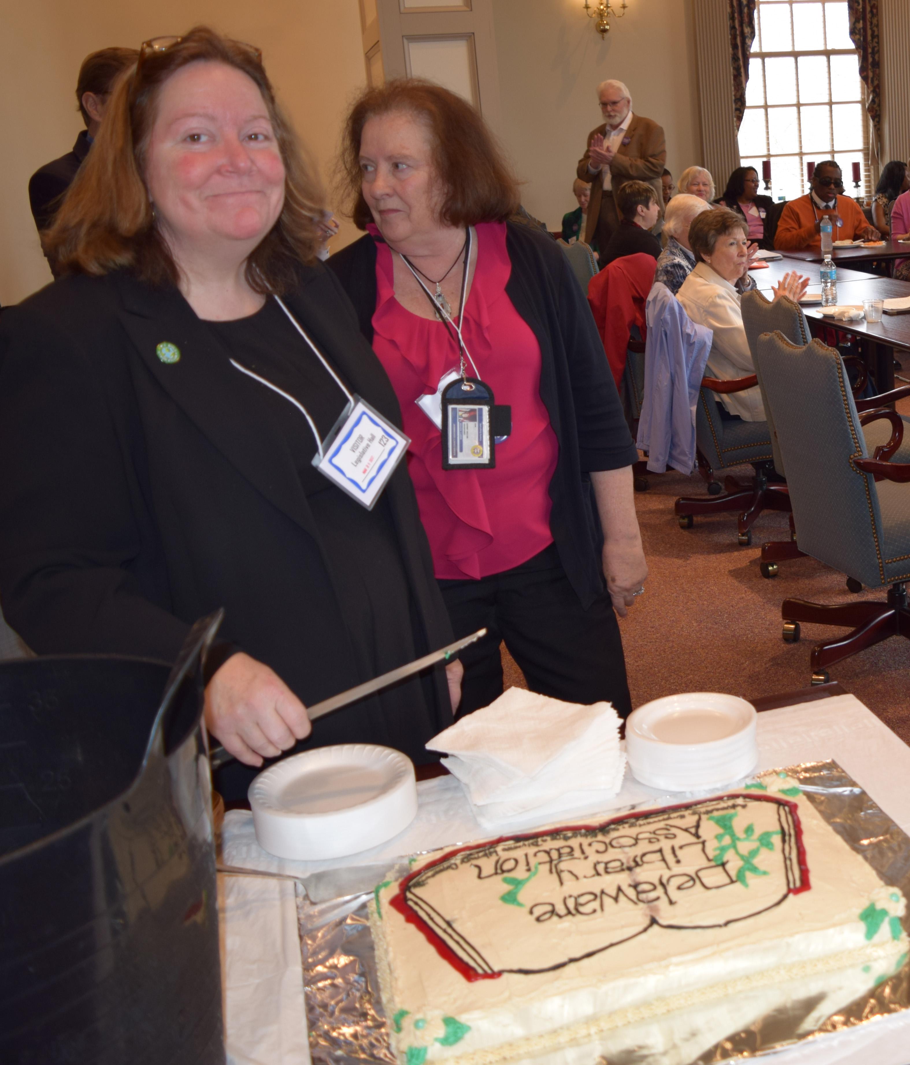 35-LunchatLegHall-Hilary Cutting Cake